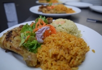 jollof rice, fried rice, chicken, salad